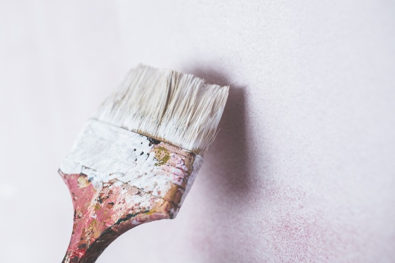brush-painting-the-white-wall